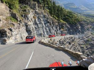 Red Jammer busses on Going To The Sun Road
